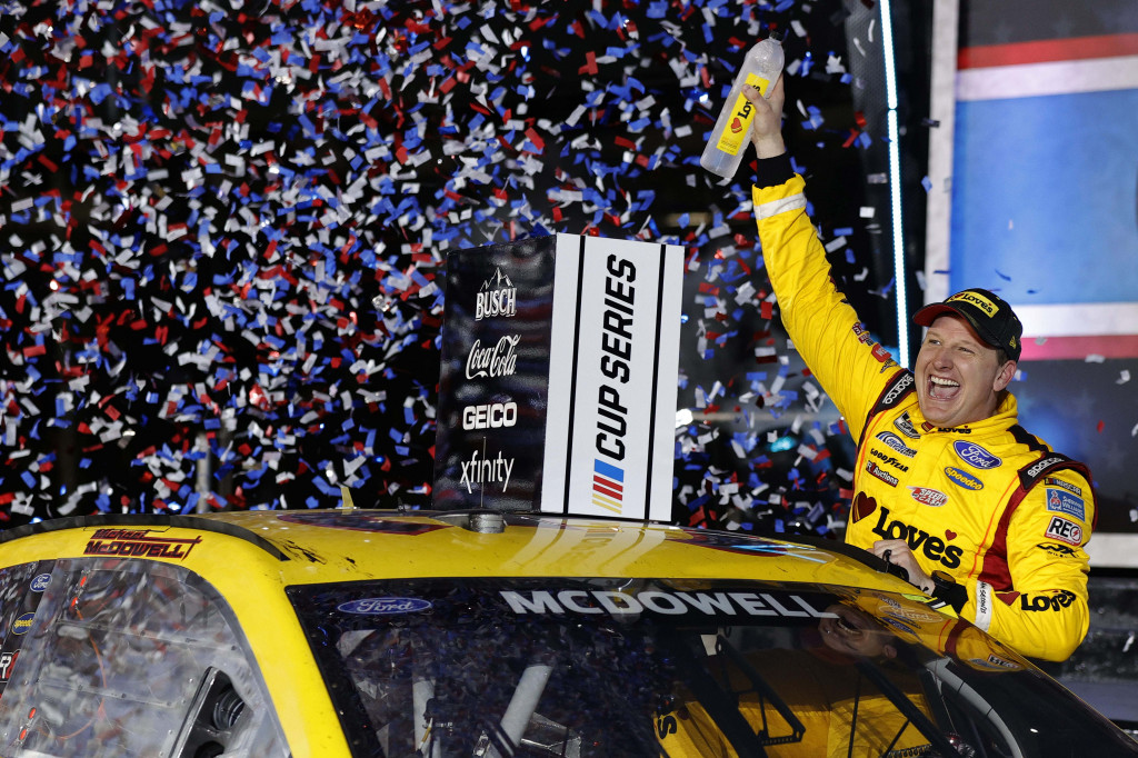 Michael McDowell, driver of the #34 Love's Travel Stops Ford, celebrates in victory lane after winning the NASCAR Cup Series 63rd Annual Daytona 500 at Daytona International Speedway on February 14, 2021 in Daytona Beach, Florida. (Photo by Jared C. Tilton/Getty Images).